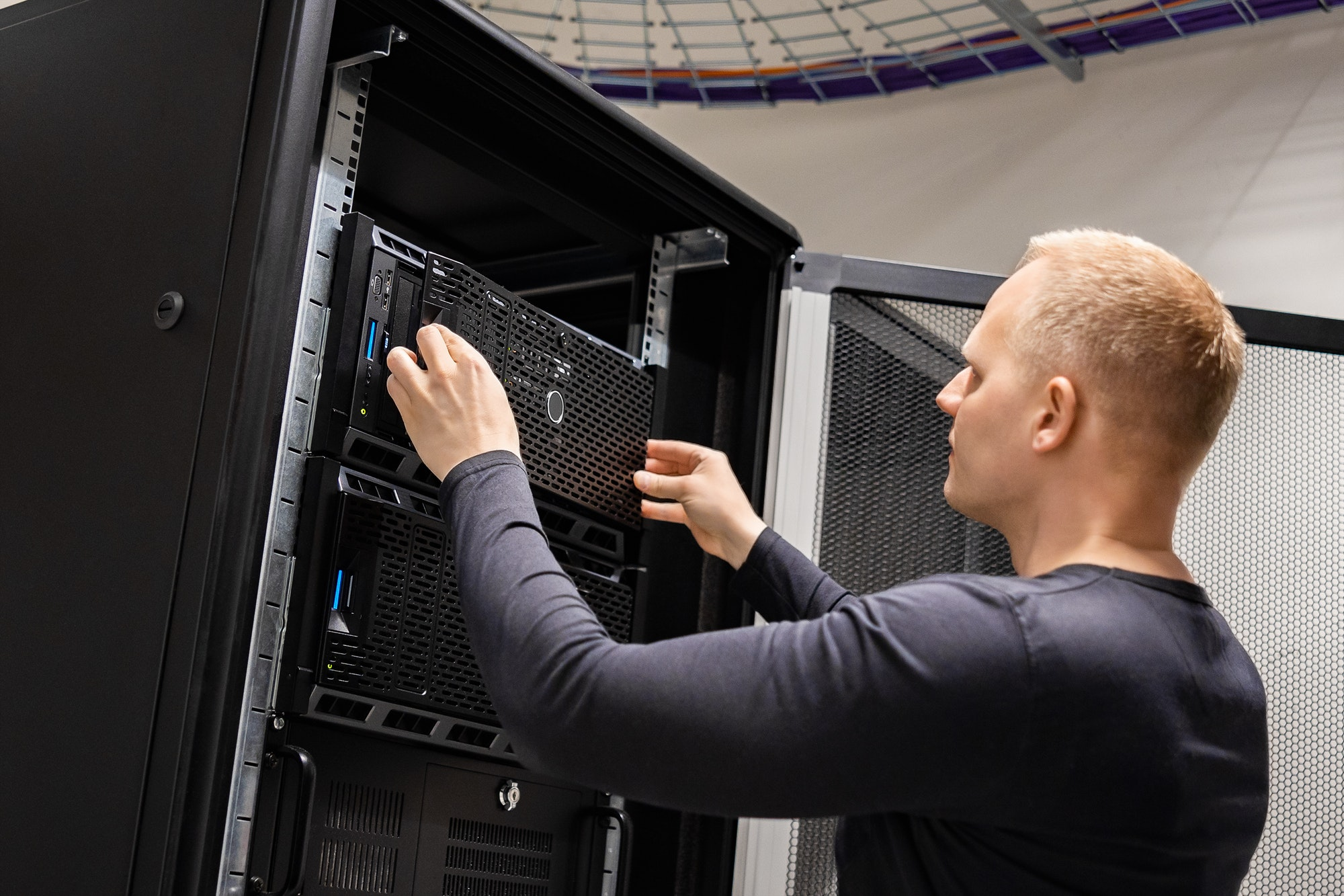 IT Engineer Working With Servers In Datacenter